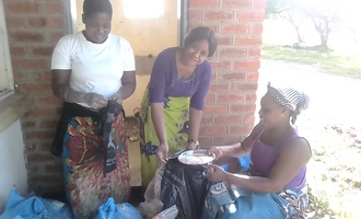 noela and two songani volunteers with soya pieces and flour 330x200